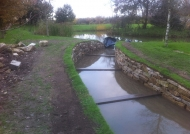 Completing the dry stone wall and water channel