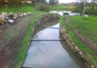 Finishing off the dry stone wall and water channel