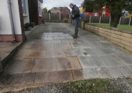 Applying chemical agents to clean driveway